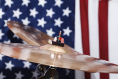 Drums, cymbals, against the backdrop of the American flag Stock Image