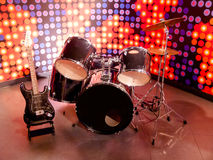Drums and guitar Stock Images