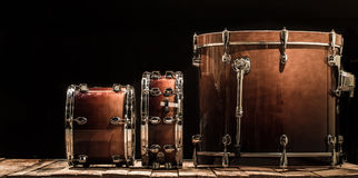 Drums, musical percussion instruments on a black background. The music concept stock photo