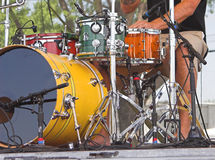 Drums at Outdoor Concert. Closeup of colorful drums on chrome stands being used at an outdoor concert Royalty Free Stock Images