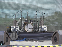 Drums set, powerfull speakers, amplifiers and stage equipment Royalty Free Stock Photo