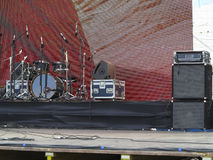 Drums set, powerfull speakers, amplifiers and stage equipment Royalty Free Stock Photography