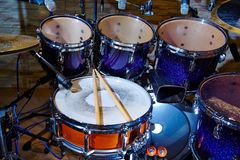 Drums set and sticks at music studio Stock Photography
