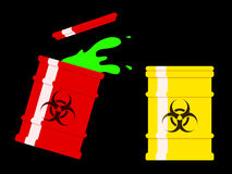 Drums with spilled green biohazard l Stock Image