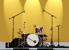 Drums on a yellow background Stock Photos