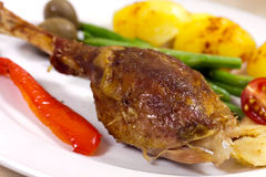 Drumstick of baked Goose with green beans,potatoes Stock Images