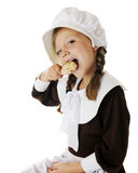 Drumstick Loving Pilgrim Girl Royalty Free Stock Photo