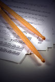 Drumstick and music sheet Stock Photography