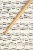 Drumstick and Music Sheet Stock Images