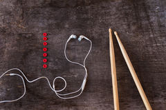 Drumsticks and earphones Stock Photo