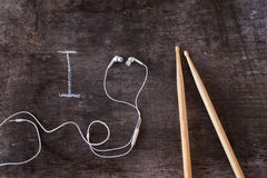 Drumsticks and earphones Royalty Free Stock Photos