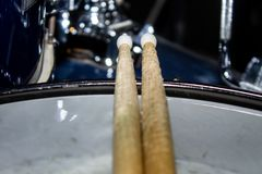 Drumsticks lie on the drum set, recording Studio, pause at the concert. 2 royalty free stock photos