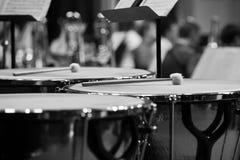 Drumsticks lying on timpani Stock Photos