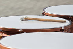 Drumsticks lying on timpani Royalty Free Stock Photography