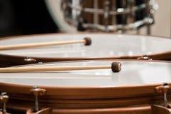 Drumsticks lying on timpani Stock Photography