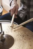 Drumsticks On Metal Cymbal Royalty Free Stock Photos