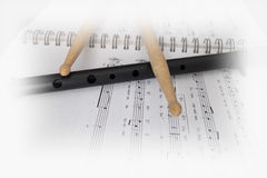Drumsticks on notes royalty free stock image