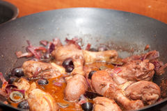 Drumsticks in wine sauce Stock Photography