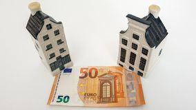 Drunen, Nederland - April 9 2019: KLM Delft Blue House with Money, Currency Euro. 50 euro. Miniature house with mortgage royalty free stock photos