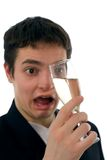 Drunk. A drunk man looking wondered and stupid to a glass of champagne Royalty Free Stock Image