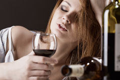 Drunk. Young beautiful woman in depression, drinking alcohol Stock Images