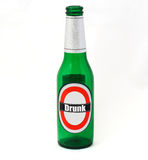 Drunk. An empty beer bottle with Drunk written on the label Royalty Free Stock Images