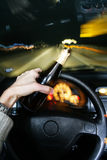 Drunk. Drinking beer while driving car Royalty Free Stock Photos