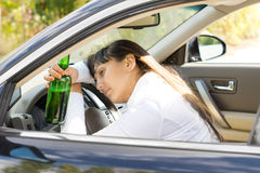 Drunk alcoholic female driver Royalty Free Stock Image