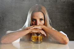 Drunk alcoholic woman wasted and depressed holding scotch whiskey glass drunk Royalty Free Stock Image