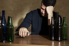 Drunk and alone stock images