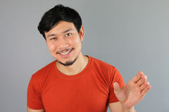 Drunk Asian man is holding a bottle. Royalty Free Stock Images