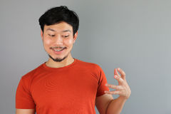 Drunk Asian man is holding a bottle. Stock Photo
