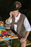 Drunk bavarian man Stock Photo