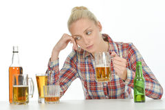 Drunk blond woman needs to stop Royalty Free Stock Images
