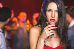 Drunk brunette looking at camera Royalty Free Stock Photography