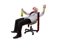 Drunk business man drinking champagne at office christmas party Royalty Free Stock Images