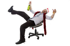 Drunk business man drinking champagne at office christmas party Stock Photography