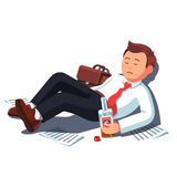 Drunk business man lying with alcohol bottle Stock Photography