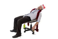 Drunk business man sleeping after drinking champagne at office christmas party Stock Photos