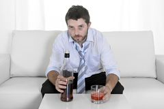 Drunk business man wasted and whiskey bottle in alcoholism Royalty Free Stock Images