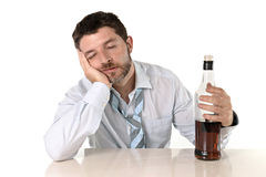 Drunk business man wasted and whiskey bottle in alcoholism Stock Photography