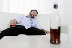 Drunk business man wasted and whiskey bottle in alcoholism Royalty Free Stock Photos