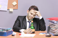 A drunk businessman. In the office stock photography