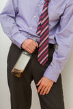 Drunk businessman with a bottle Royalty Free Stock Photos
