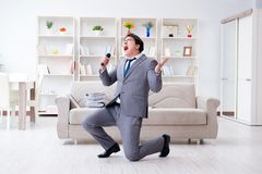 The drunk businessman celebrating in the office Stock Photos