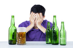 Drunk businessman closing his face Royalty Free Stock Photo
