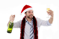 Drunk businessman drinking champagne wearing santa hat isolated white background Royalty Free Stock Photos