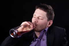 Drunk businessman drinking wine Royalty Free Stock Photos