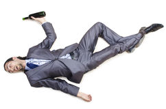Drunk businessman on  floor Stock Images