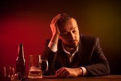 Drunk Businessman. Drunk Sad Businessman Sleeping in a Bar Stock Photos